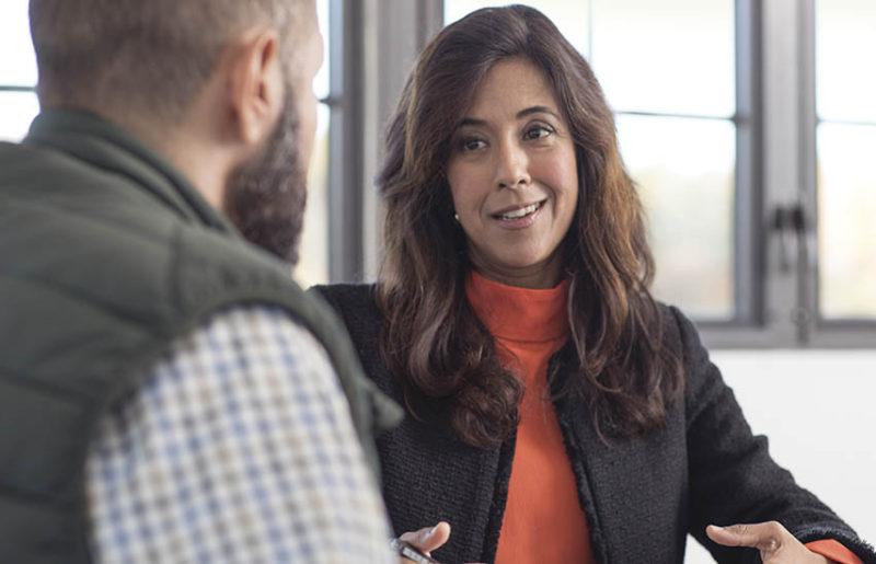 Employer talking to employee