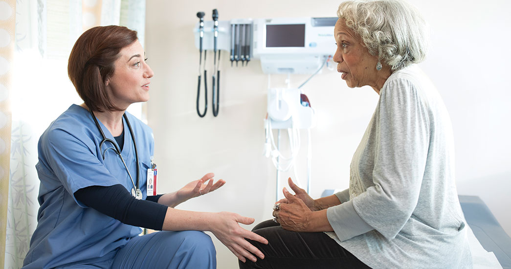 Doctor answering questions about health care to a patient